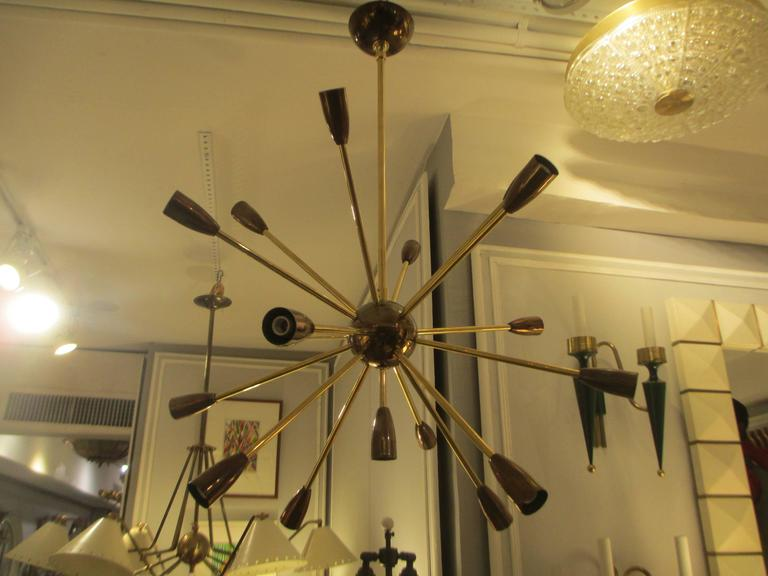 Custom brass and copper sputnik chandelier with 14 arms.