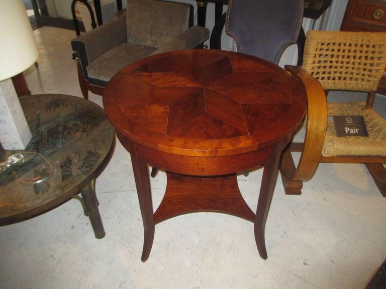 Parquetry walnut center table with starburst pattern.