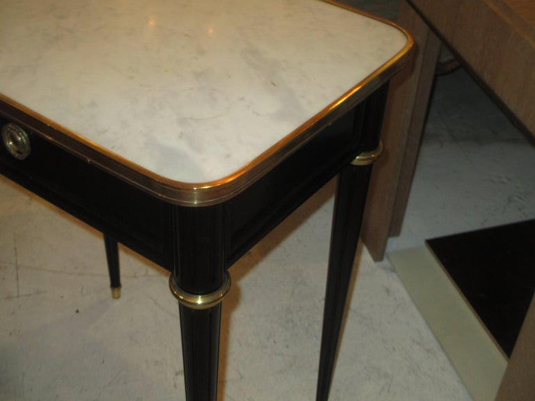 Pair of Ebonized Jansen Marble Top End Tables In The Louis XVI Manner In Excellent Condition For Sale In New York, NY