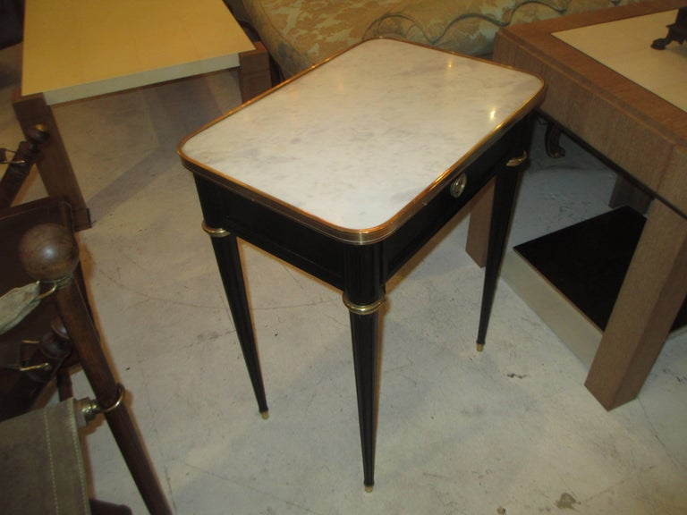 French Pair of Ebonized Jansen Marble Top End Tables In The Louis XVI Manner For Sale