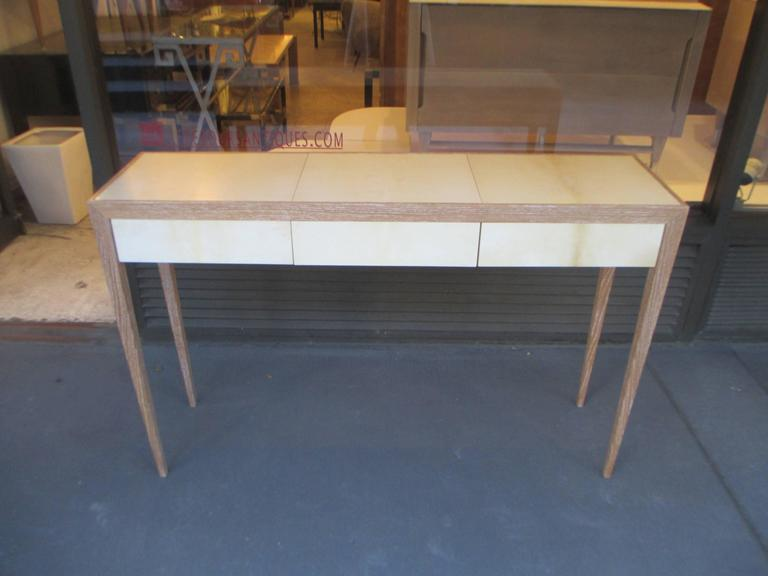 A custom cerused-oak and parchment console table in the Jean Michel Frank Manner.