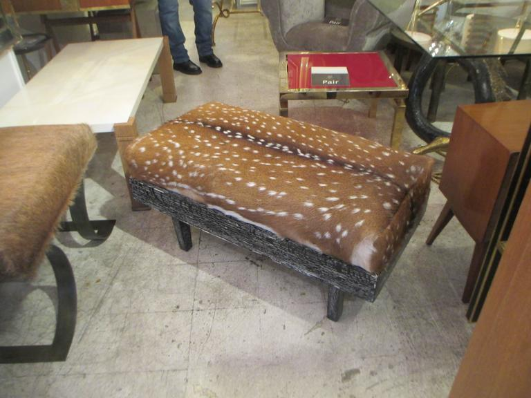 A Pair Of Black Cerused Oak Deer Hide Upholstered Benches.