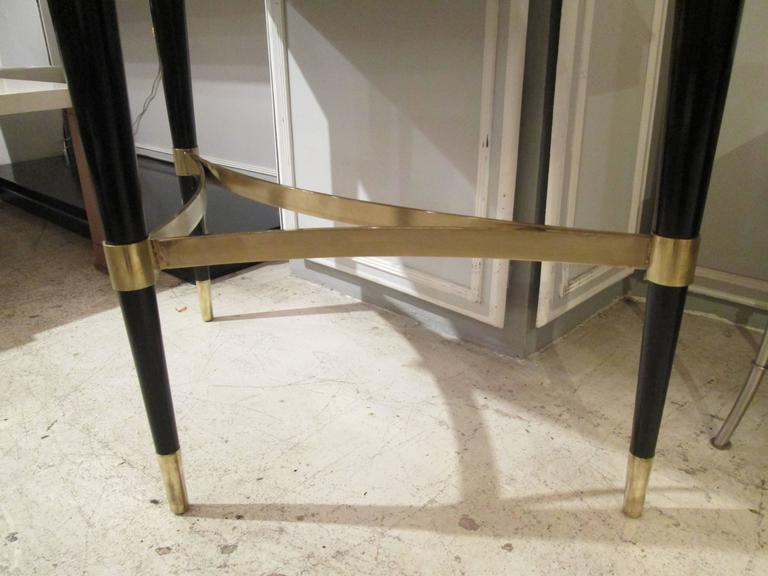 20th Century Pair of Sculptural Ebonized Consoles on Tripod Base with Bronze Stretchers For Sale