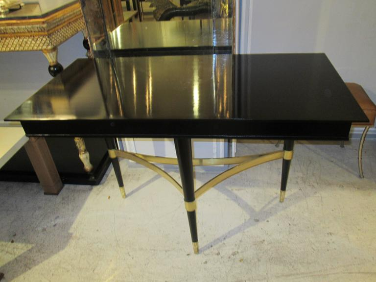 American Pair of Sculptural Ebonized Consoles on Tripod Base with Bronze Stretchers For Sale