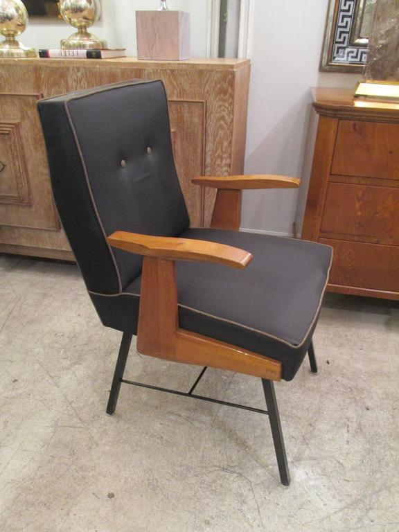 A pair of Mid-Century Italian armchairs on iron base upholstered in horse hair.