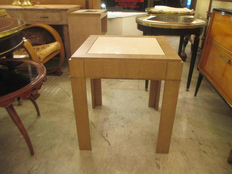 Custom cerused-oak side table with parchment top and bronze banding, the table has one pull-out drawer and is inspired by the designs of Jean Michel Frank. The top on this table is offered in three different finishes goatskin, sheepskin or mica.
