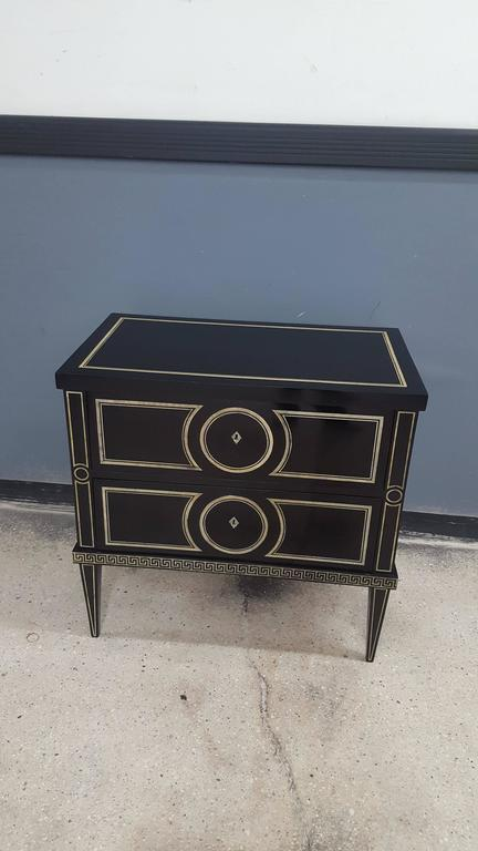Whimsical pair of Custom ebonized commodes featuring neoclassic hand-painted decoration, reminiscent of Fornasetti's Designs. Turnaround time 8 to 12 weeks