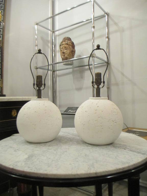 Pair of textured circular plaster lamps.