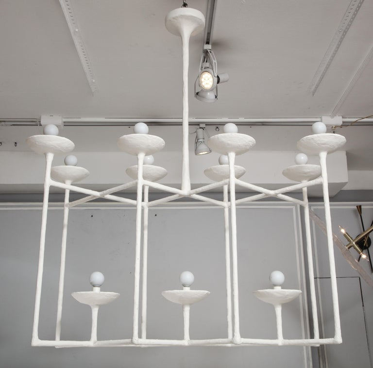 Plaster fixture in the manner of Giacometti with eleven lights.
