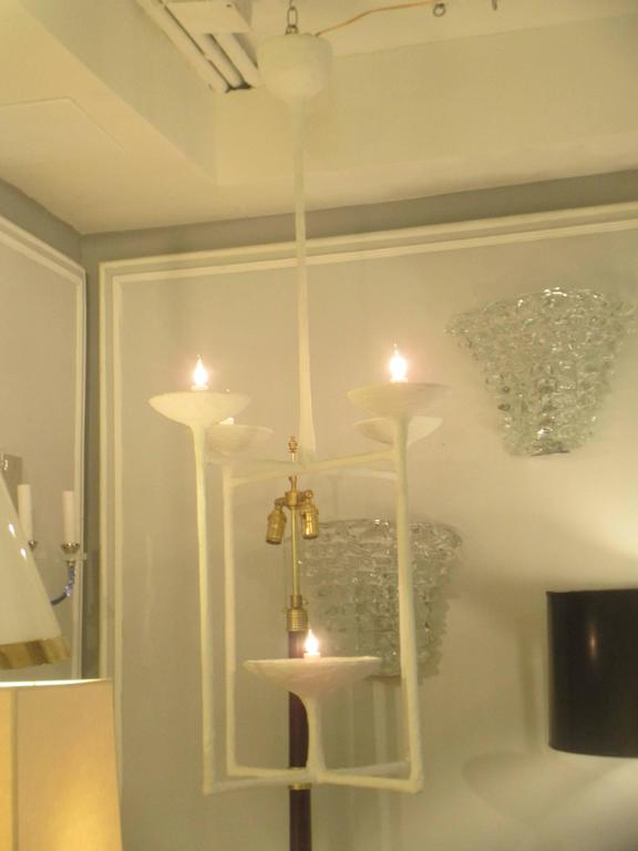 Custom plaster fixture in the Giacometti manner with five lights.