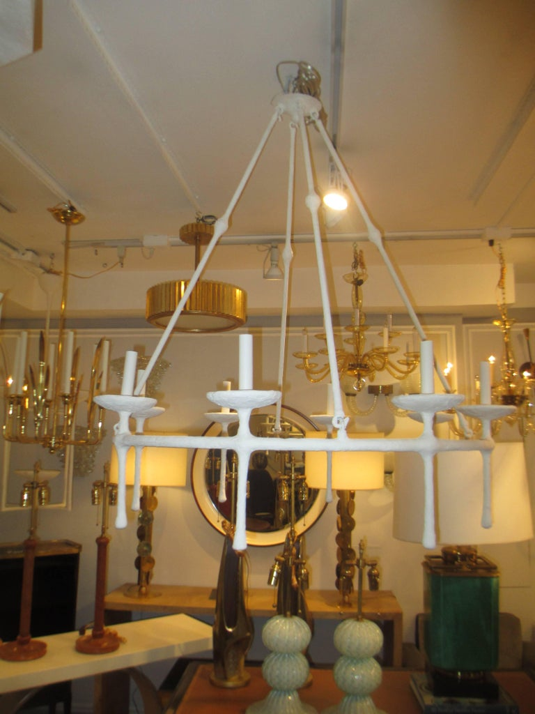 Custom eight-arm plaster fixture in the Giacometti Manner. This chandelier can be customized in any size.