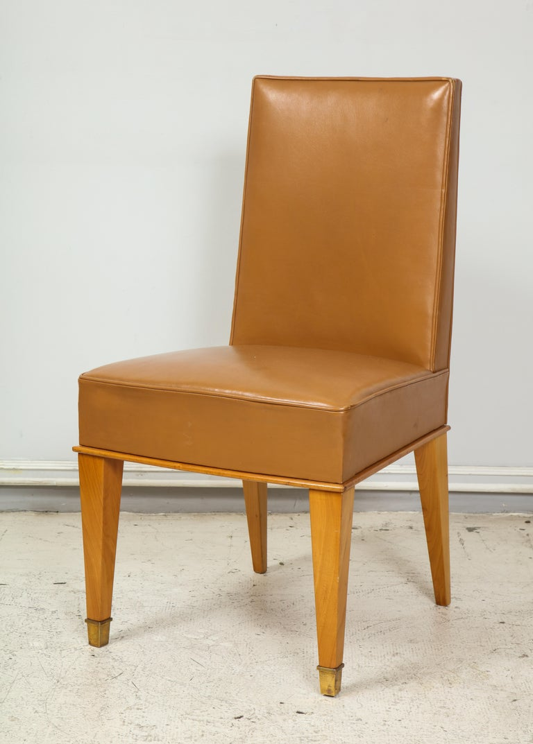 A set of ten French 1940s Leather Upholstered Dining Chairs, Very Comfortable