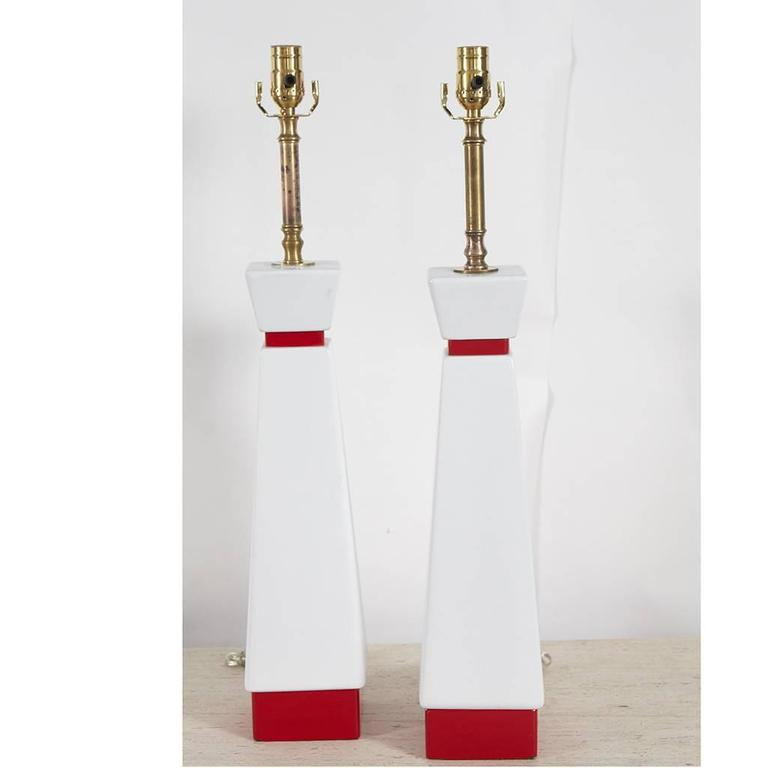 This pair of painted wood lamps reminds us of Chapman or Rembrandt Lamps we have seen, but without a makers mark cannot be sure which. The lamps have a great look a great red and white painted finish and have been recently re-wired. The pair is sold