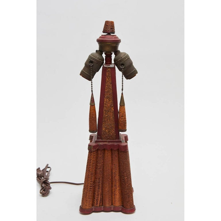 This incredible lamp appears to have been made by an artist or craftsman using corn cobs and scrap wood. The piece has a wonderful design reminiscent of architecture from the period.