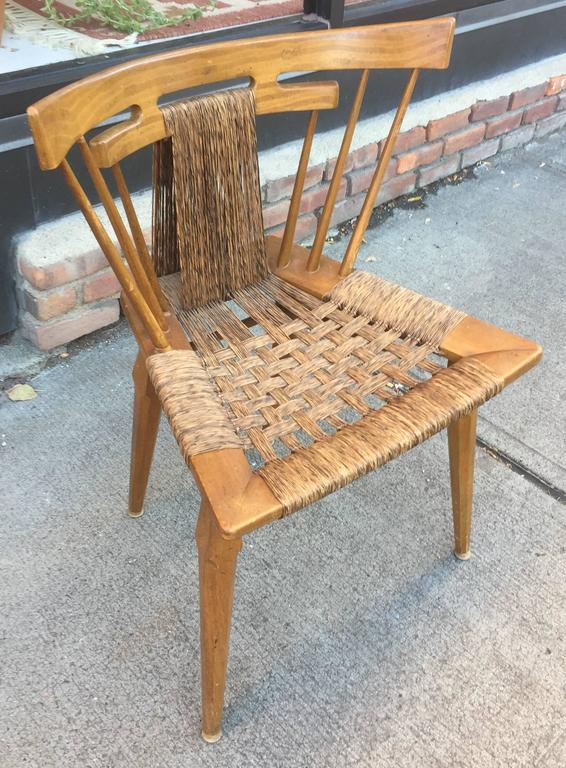 Solid mahogany frame with original hand-rolled grass rushing. American designed, Mexican made chairs incorporated a lavish, exotic south-American Fantasia for the American market.