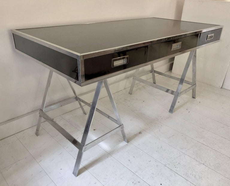 Example of the Classic Albrizzi trestle desk in polished aluminium and mirrored chrome finish, circa 1970. Three dovetailed drawers with inset pulls raised on sawhorse legs. Unsigned.
