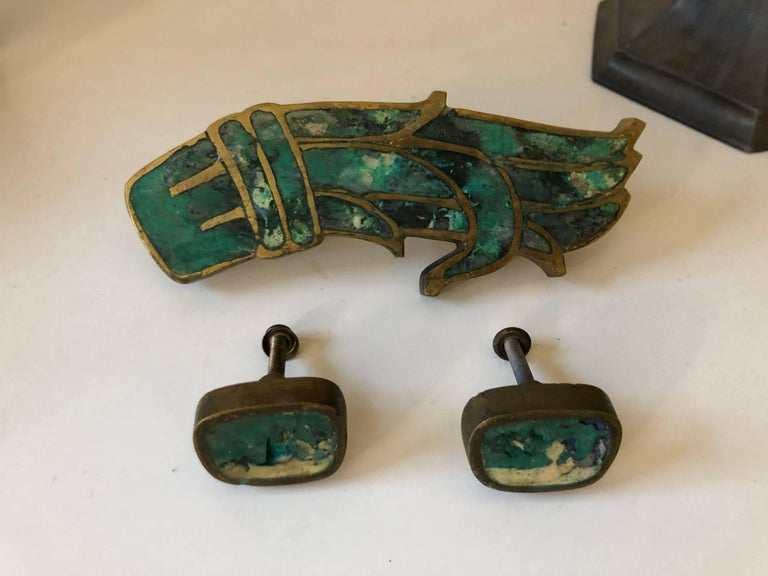 Mid-century Pepe Mendoza drawer pulls in brass with ceramic inlay. The larger is signed with impressed manufacturer's mark [Mendoza Hecho en Mexico].  Three pieces total.