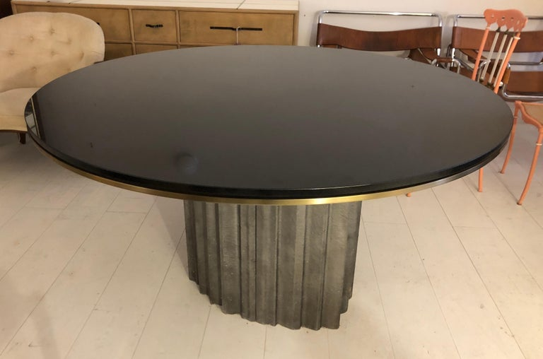 Fantastic cast aluminum dining table base in a hard organic form, with 56