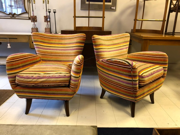 Classic Schwadron lounge chairs with carved walnut legs in a vintage striped cotton velvet.