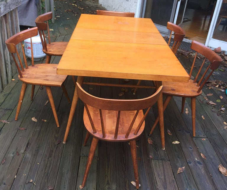 "Handsome solid maple dining table with two leaves and six spindleback chairs made for the Winchendon Furniture Company. The table without leaves is 60"", and expands to a total of 84"" (12"" w leaves), comfortably accommodating 8 place settings. This"