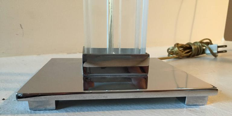 Thick lucite stem with incised center channel on each side sites in chromed base with chrome accents.  Highest quality construction.