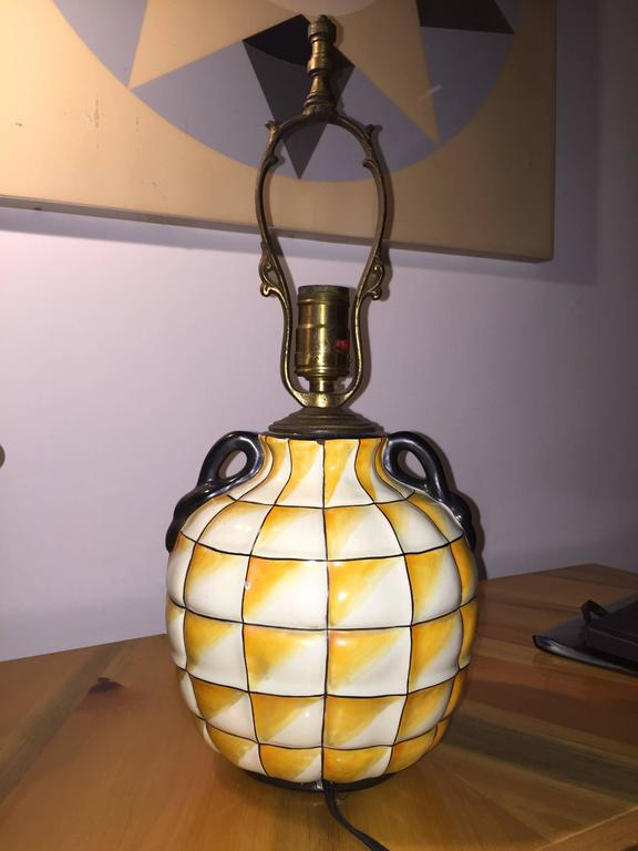 Fantastic pottery lamp with hand-painted opt-art gridded base with swan-form handles. The vase form is pictured in a 1928 issue of Art et Decor featuring Gio Ponti's designs for the Ginori factory. This example was cast as a lamp base, with molded