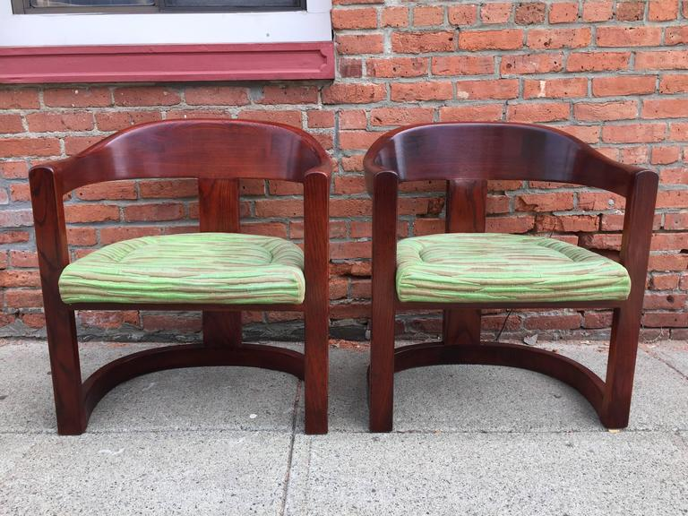 Original oxblood red mahogany stained chairs with complimentary red and green silk fabric seats. Wonderful mix of color and form.
