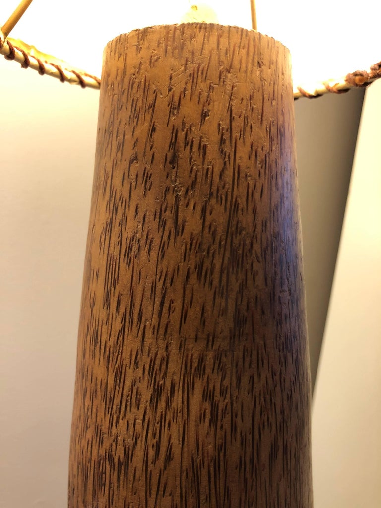 Solid lathe-carved tapering column of palm wood  with inverse cone shade. Unsigned, but likely a South American design. Floor dimmer on/off switch. Total height with shade is 84 inches with shade diameter 18""