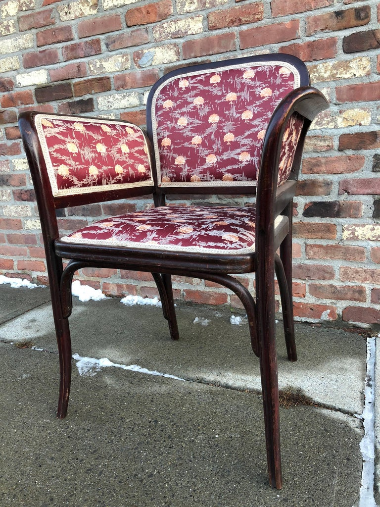 Unusual bentwood chair with flaring side arms, upholstered in Secessionist-style fabric. Thonet stamp to interior frame.