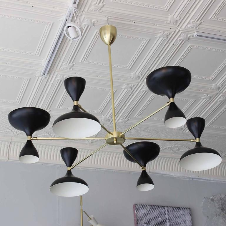 Our own exclusive sunburst design Milano chandelier, with six brass arms and pivoting powdercoated heads with up and down sockets. In black or white or both. All made in Italy.