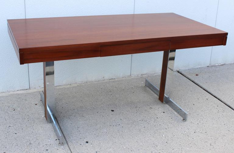A Milo Baughman style sleek and modern chrome frame desk with rosewood top and leg inlay detail.