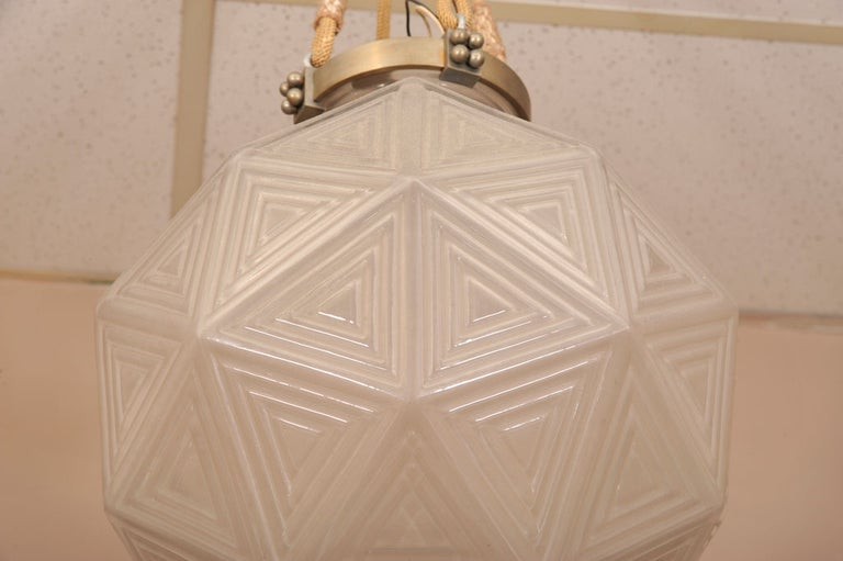 Lalique boule-type chandelier, clear and frosted glass molded with a geometric motif, electrified.