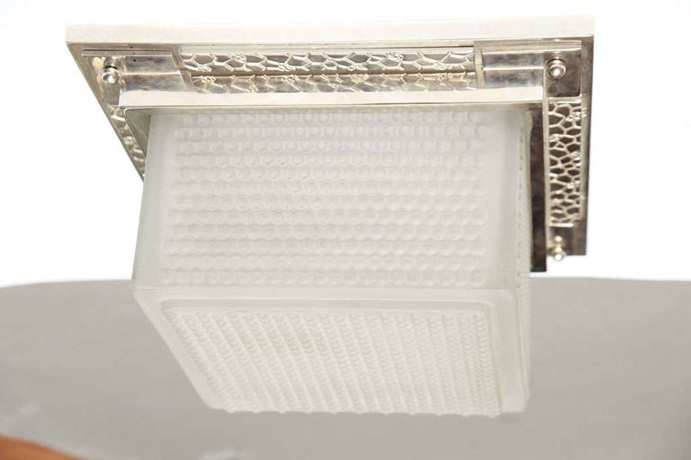 A French Art Deco ceiling flushed square fixture in molded frosted glass mounted in nickel-plated bronze frame, circa 1930. Signed Robert Caillat in the mold.
