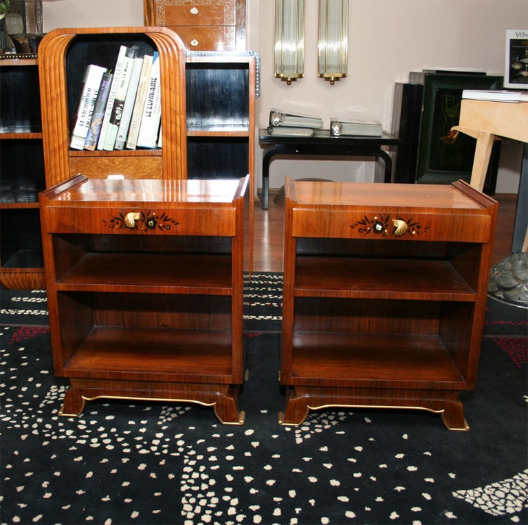 A pair of French Art Deco side tables, circa 1930s signed LELEU, in rosewood with mother of pearl inlaid.