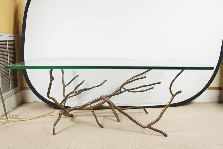 A custom welded steel with bronze finish, coffee table by Jeffery Budd.
