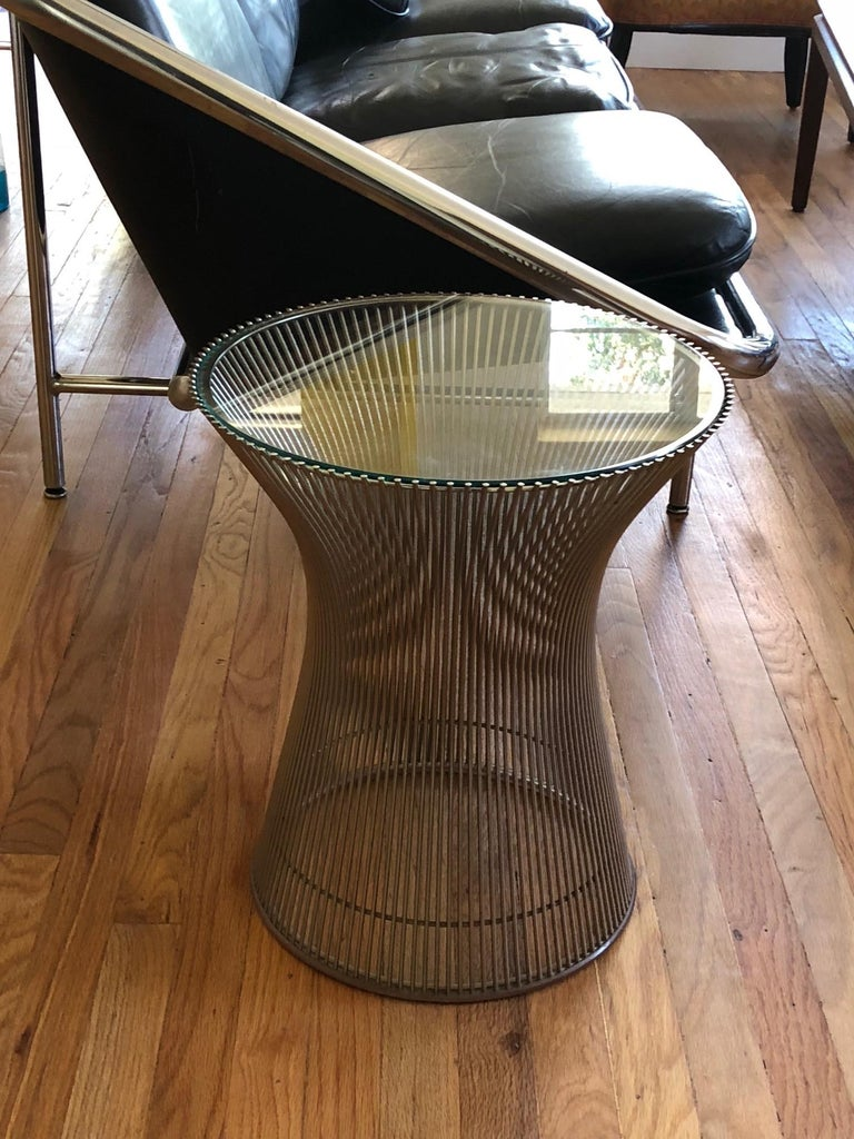 A classic Warren Platner for Knoll side table with glass top and chromed base.