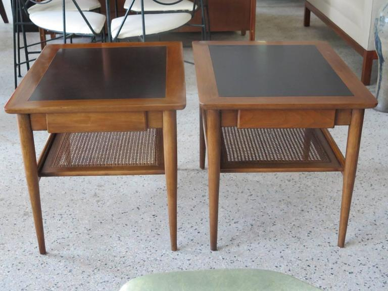 A Pair of American of Martinsville Occasional Tables with Caned Shelf For Sale 1