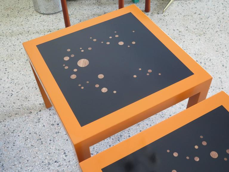"A pair of unusual, Parsons style ""Constellation"" tables by Dunbar. Orange laquer with circular inlays."
