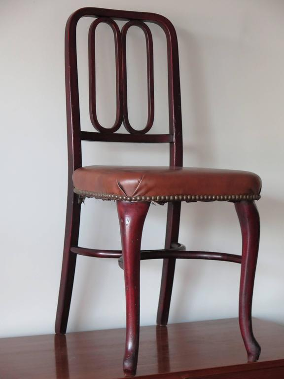 A rare, Thonet bentwood chair with original labels and upholstery. Made in Vienna, Austria and sold in NYC.