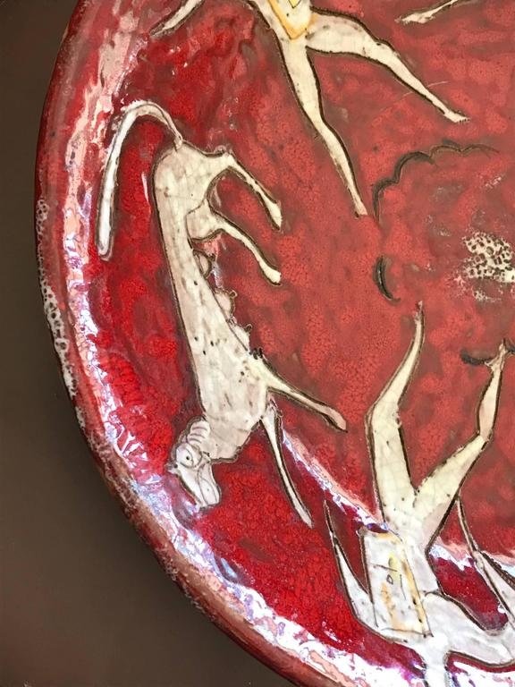 A fantastic and rare ceramic charger by Eugenio Pattarino. Vibrant red color and Classic Italian Mid-Century style is represented very well in this piece. Eugenio Pattarino was born in 1885 and passed away in 1971. He was a master sculptor and model