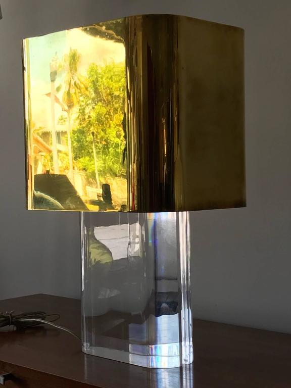 A rare Karl Springer table lamp. Lucite with polished brass shade. Included original receipt, from 1980.