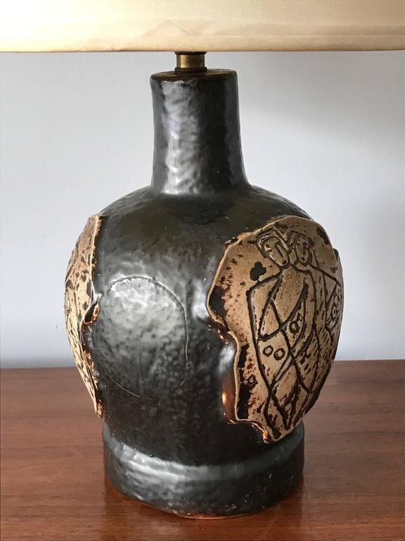 An unusual 1950s ceramic lamp with stylized decoration.