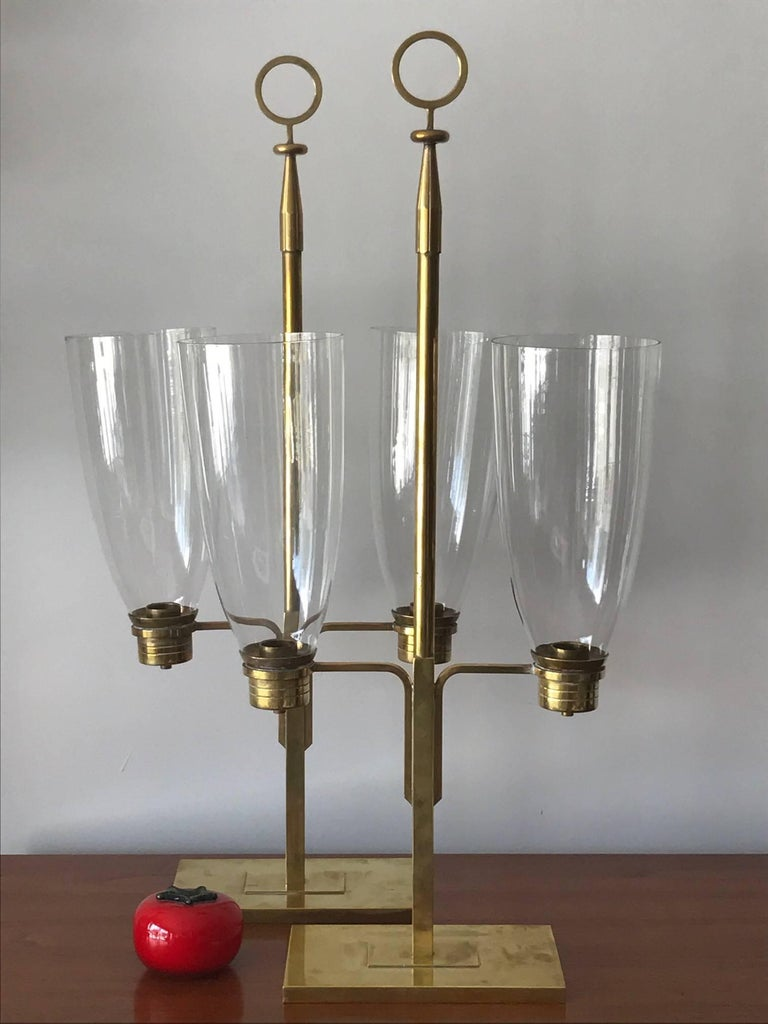A pair of hurricane lamps by Tommi Parzinger. Manufactured by Dorlyn Silvermiths.