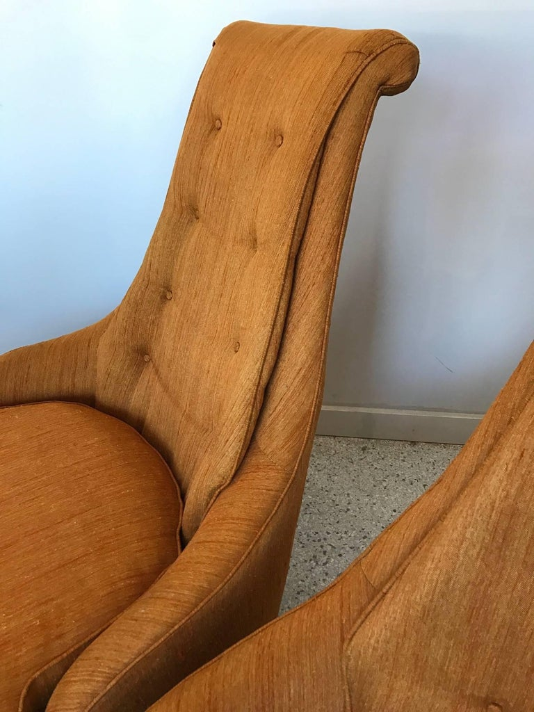 A pair of unusual high back, upholstered slipper chairs by Karpen of California. Original fabric and labels. These chairs are very comfortable and elegant. On chunky, tapered wood legs. Seat height is approx. 16.5
