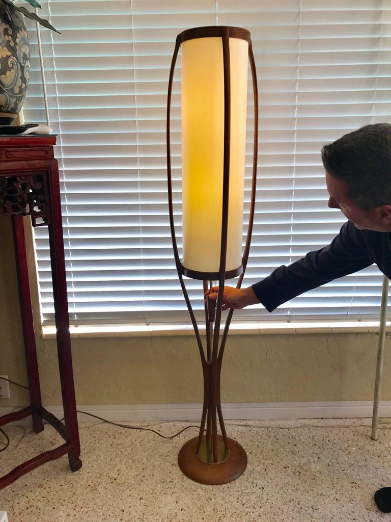 An unusual floor lamp by Modeline. Walnut, organic design with a sculptural feel. Shade replaced and rewired.