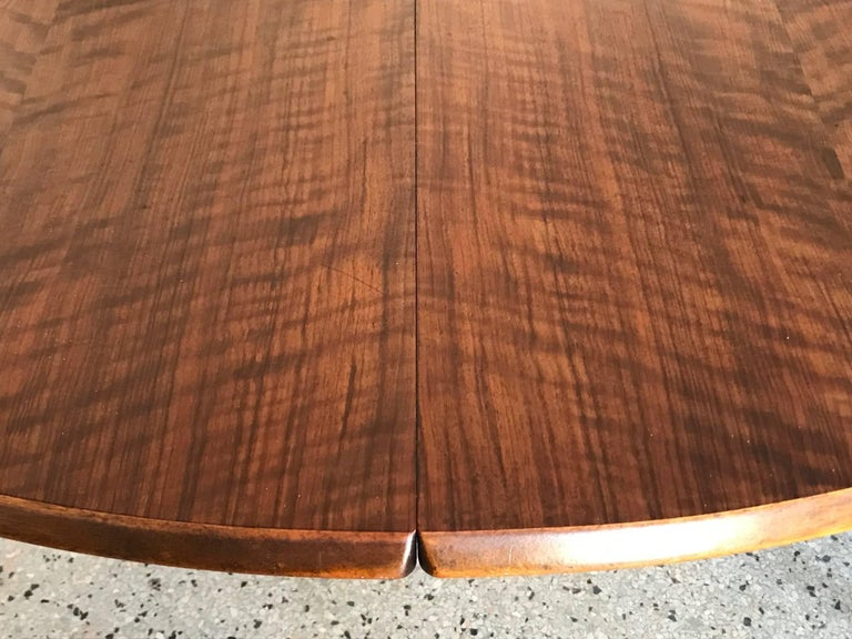 A fine Kurt Ostervig Danish dining table. Highly figured walnut with two leaves (21.5