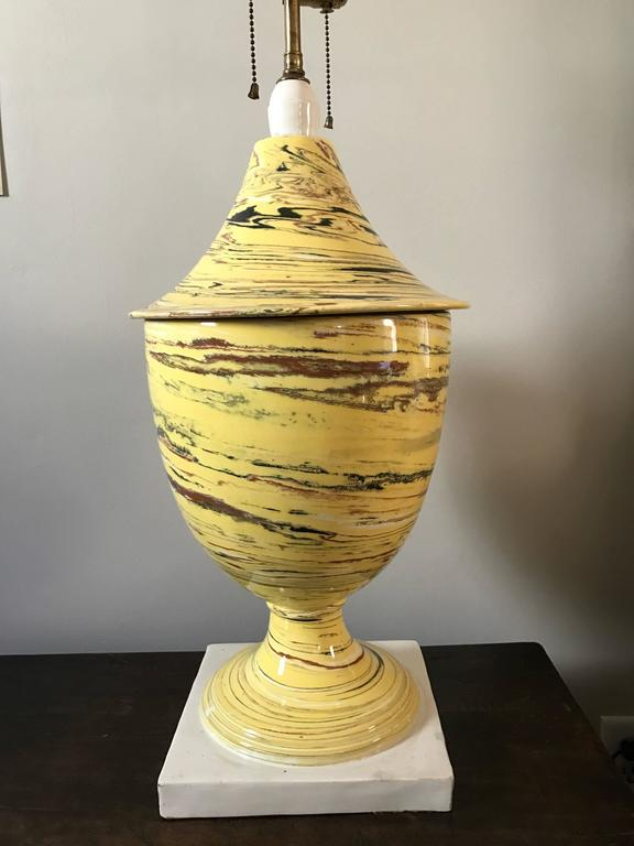 An Italian Mid-Century large-scale neoclassical glazed ceramic lamp. The urn form with yellow black, red and white swirls in an agate ware style, white plinth.