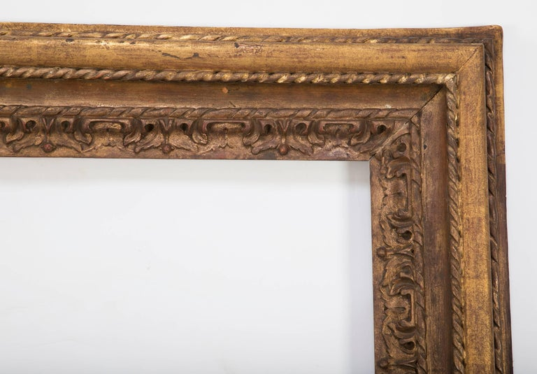 Large-scale Italian Baroque style carved and gilt wood picture frame with the original gilding. With beveled glass. Provenance: Formerly in the collection of the Higgins Armory Museum, MA.  Measure: 50.75 by 47.5 inches.