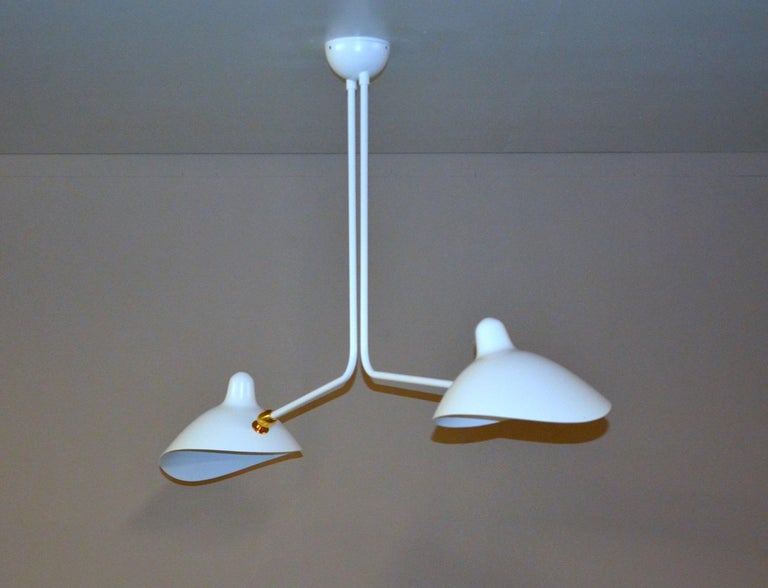 Simple and unique this ceiling lamp has two symmetrical curved arms which are fixed, with shades that can be rotated to any position. An elegant lamp with a small footprint that gives character to any room.   Available in white or black.