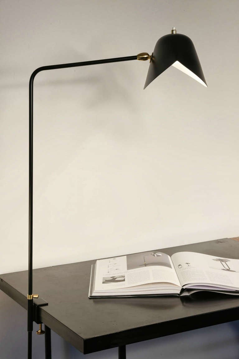 Clamp desk lamp. At 36 inches at its highest, these lamps may affix to many surfaces providing direct lighting where it is needed.